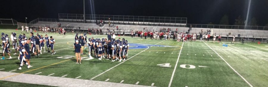 The Juan Diego football team at their post game huddle after their first home game.