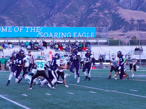 Juan Diego's Jayden Madry stops South Summit's running back from his first down drive.