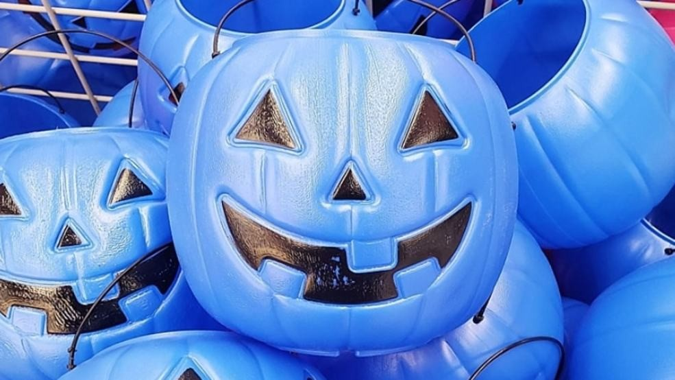 Blue pumpkin-shaped candy buckets make Halloween easier for the Autistic community.