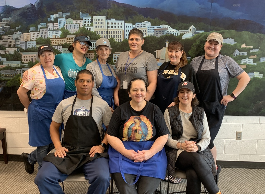 The lunch staff gathers for a group photo. Every day the group provides quality food for JD students.