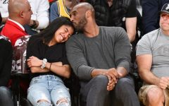 Kobe with his daughter, courtside, at a Los Angeles Lakers and Atlanta Hawks NBA game.