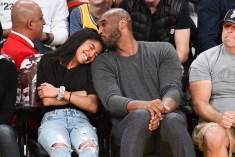 Kobe with his daughter, courtside, at a Los Angeles Lakers and Atlanta Hawks NBA game.