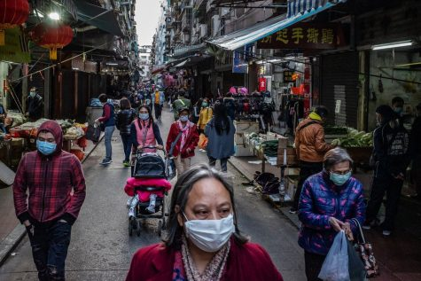 People fill the streets of Macau, China, donning face masks to protect from the spreading Coronavirus.