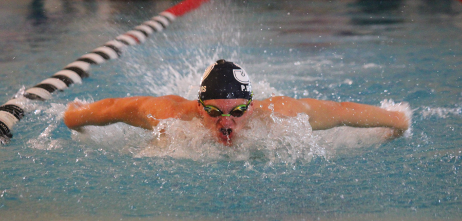 Junior Payton Bouwhuis swims for the gold at State.