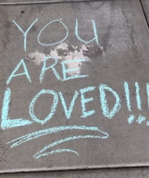 A message to all of the seniors, written in chalk at the entrance of the school.