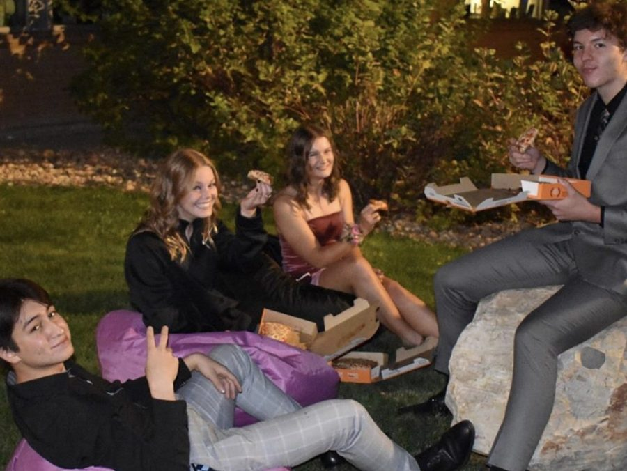 Seniors enjoy their food-truck dinner at the outdoor seating.