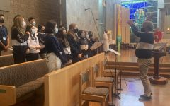 John VanWagoner directing the choir at the Junior Class Mass last Thursday.