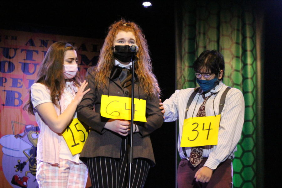 Olivia Thomas is comforted by Kaitlyn Woods and David Kale in a performance of The 25th Annual Putnam County Spelling Bee