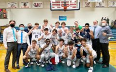 JD Boys Basketball celebrates its regional championship victory.