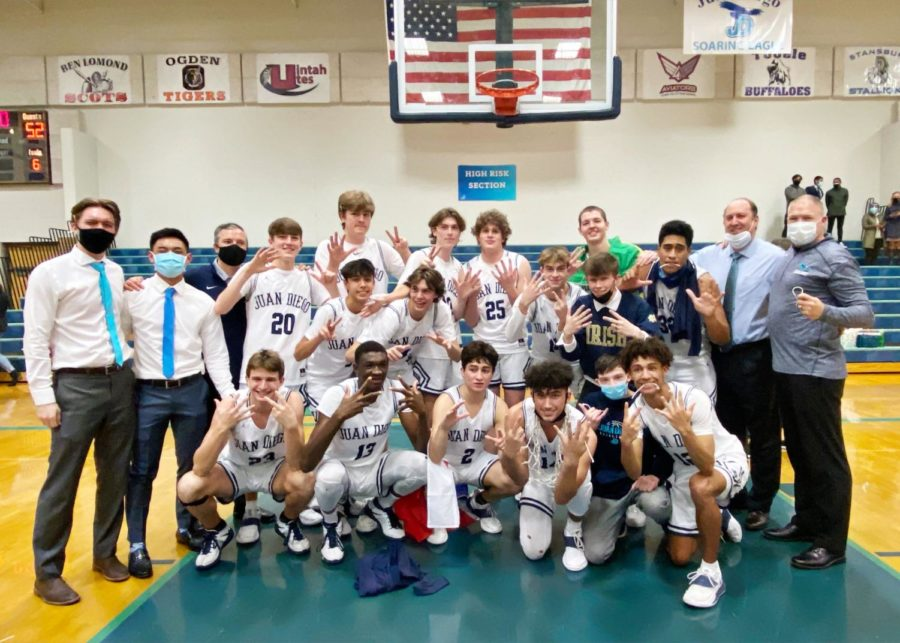 JD Boys Basketball celebrates its regional championship victory.