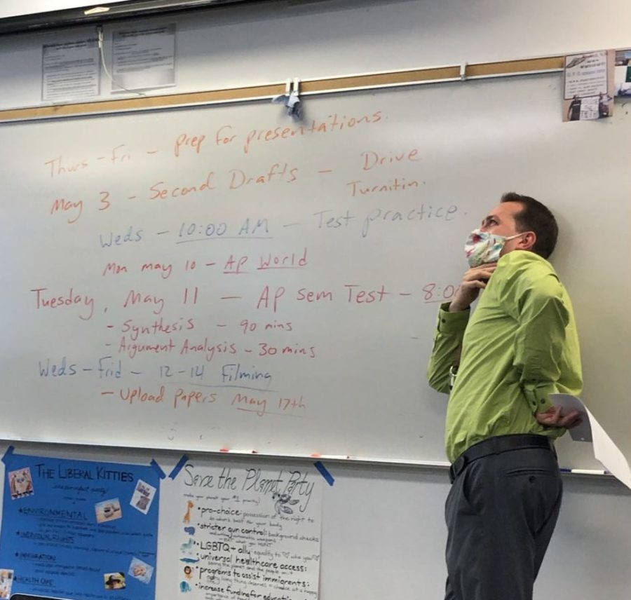Mr. Dave Hausser reviewing the end of year schedule for AP Seminar