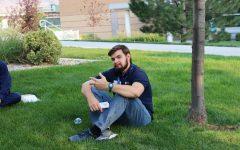 John O'Neill relaxing on grass during a school retreat.