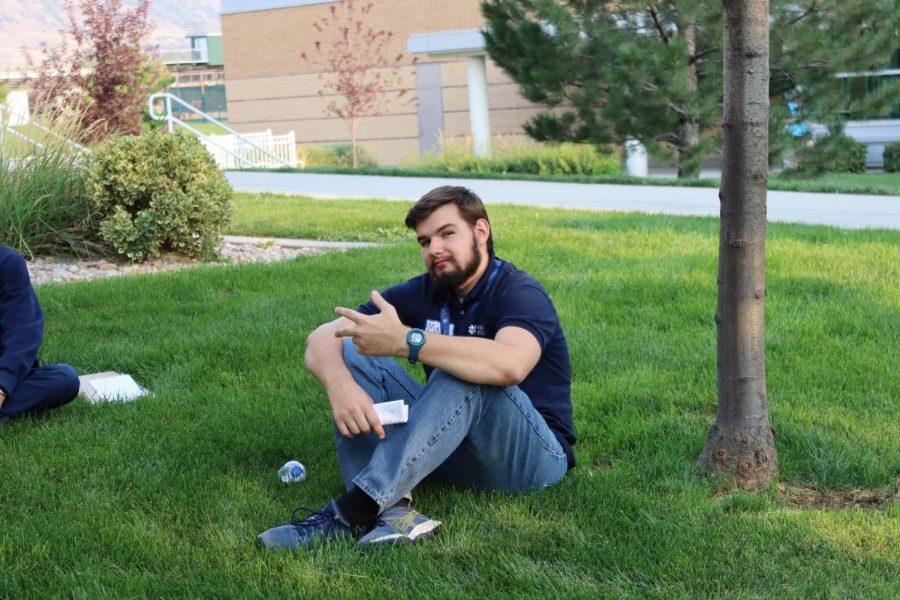 John ONeill relaxing on grass during a school retreat.