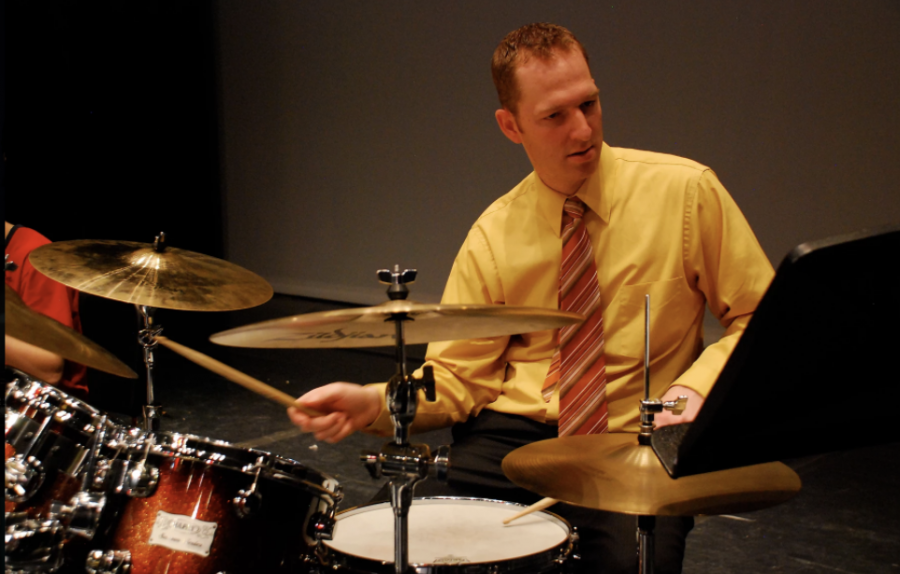 Former Band Director from 2018-2019, Jed Blodgett, jamming out on the drums.